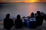 Friends watching the sunset from the Muir Beach overlook, Marin County, California