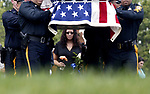 Funeral for Perth Amboy Police Officer Thomas Raji. Funeral procession into the Alpine Cemetery in Perth Amboy where Officer Raji will be laid to rest. Here as fellow Perth Amboy Police officers carry the casket of Raji, his wife (center) Marisol Raji follows behind the procession. <br /> <br /> METRO<br /> 3173<br /> ON MON AUG 25 ,2008<br /> MARK R. SULLIVAN/CHIEF PHOTOGRAPHER