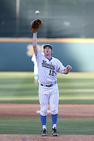 Grant Watson (12) of the UCLA Bruins pitches during a game against the Hofstra Pride at Jackie Robinson Stadium on March 14, 2015 in Los Angeles, California. UCLA defeated Hofstra, 18-1. (Larry Goren/Four Seam Images)