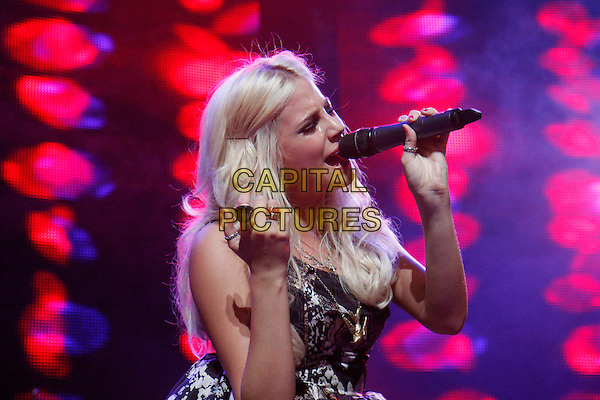 PIXIE LOTT (Victoria Louise Lott).Performs live at the Roundhouse, Camden, London, England, UK, July 20th 2010..music gig on stage concert half length prom dress microphone singing black silver grey gray print patterned hand rings .CAP/MAR.© Martin Harris/Capital Pictures.