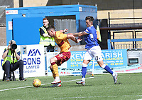 Declan Gallagher shielding the ball from Connor Murray in the SPFL Betfred League Cup group match between Queen of the South and Motherwell at Palmerston Park, Dumfries on 13.7.19.