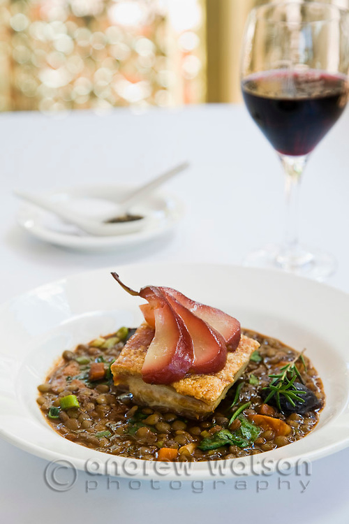Pork belly with glazed pear and lentils at C'est Bon Restaurant.  Cairns, Queensland, Australia