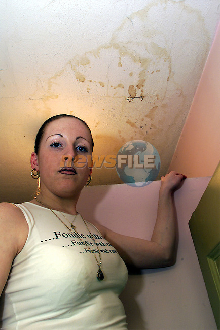 Mandy Levins shows the damaged ceiling in her bathroom at Paradise Place..Picture: Arthur Carron/Newsfile