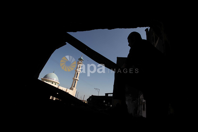 A Palestinian man inspects El-Awda factory that witnesses said was shelled by Israel during its offensive, in Gaza City September 16, 2014. An open-ended ceasefire between Israel and Hamas-led Gaza militants, mediated by Egypt, took effect on August 26 after a seven-week conflict. It called for an indefinite halt to hostilities, the immediate opening of Gaza's blockaded crossings with Israel and Egypt, and a widening of the territory's fishing zone in the Mediterranean. Photo by Ashraf Amra