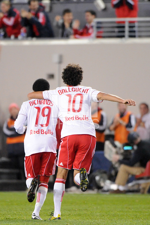 Dane Richards (19) of the New York Red Bulls celebrates scoring with Mehdi Ballouchy (10). The New York Red Bulls defeated the New England Revolution 2-0 during a Major League Soccer (MLS) match at Red Bull Arena in Harrison, NJ, on October 21, 2010.