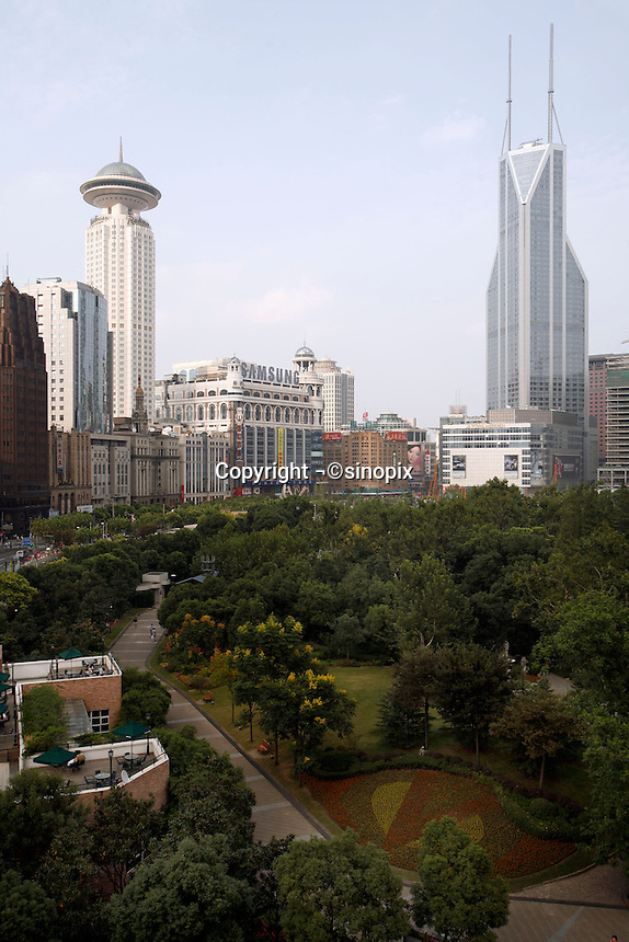 A view of People's Park and downtown Shanghai from the Shanghai Art Museum in Shanghai, China. The museum is located in a colonial era building, formerly the clubhouse of the Shanghai Race Track, some of which is now the park and houses also the Shanghai Museum of Contemporary Art..15 Sep 2006.