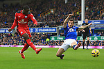 Leicester's Jeff Schlupp strikes at goal past Leighton Baines of Everton - Everton vs. Leicester City - Barclay's Premier League - Goodison Park - Liverpool - 22/02/2015 Pic Philip Oldham/Sportimage