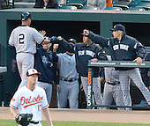 New York Yankees shortstop Derek Jeter (2) is congratulated by his teammates after scoring on a Mark Teixeira (25) single in the first ining against the Baltimore Orioles at Oriole Park at Camden Yards in Baltimore, MD on Monday, April 9, 2012..Credit: Ron Sachs / CNP.(RESTRICTION: NO New York or New Jersey Newspapers or newspapers within a 75 mile radius of New York City)