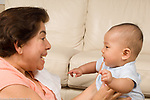 4 month old baby boy Chinese American horizontal interaction with caregiver