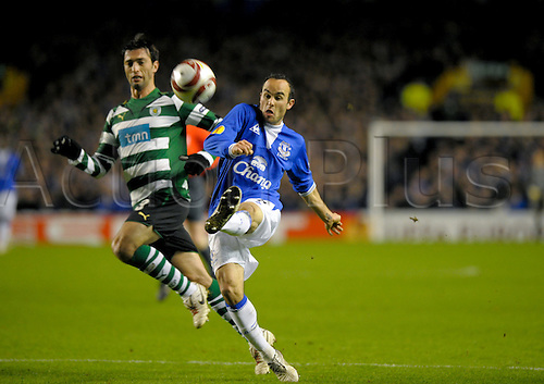2010 Everton v Sporting Feb 16, Goodison Park. Landon Donavon of Everton competes for a high ball against Sporting Lisbon defender. Photo: Alan Edwards/Actionplus. - Editorial Use