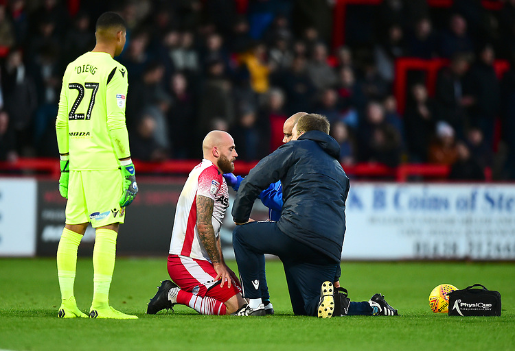 Stevenage's Scott Cuthbert receives treatment after clashing with Lincoln City's John Akinde<br /> <br /> Photographer Andrew Vaughan/CameraSport<br /> <br /> The EFL Sky Bet League Two - Stevenage v Lincoln City - Saturday 8th December 2018 - The Lamex Stadium - Stevenage<br /> <br /> World Copyright © 2018 CameraSport. All rights reserved. 43 Linden Ave. Countesthorpe. Leicester. England. LE8 5PG - Tel: +44 (0) 116 277 4147 - admin@camerasport.com - www.camerasport.com