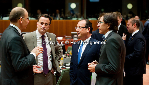 Brussels-Belgium - December 20, 2013 -- European Council, EU-summit, meeting of Heads of State / Government; here, Enrico LETTA (le) - Prime Minister of Italy, Xavier BETTEL (2.le) - Prime Minister of Luxembourg, Francois (François) HOLLANDE (2.ri) - President of France, and Elio DI RUPO (ri) - Prime Minister of Belgium, at the start of a plenary session -- Photo: © HorstWagner.eu