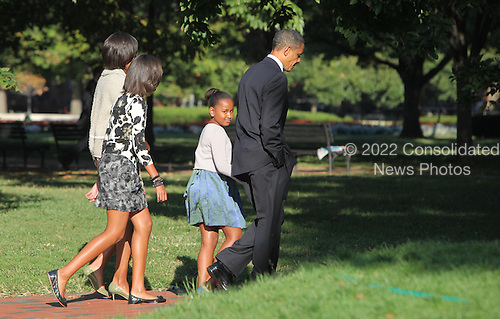 Sasha Obama looks back at the photographer as the First Family walks across LaFayette Park to St. John's Episcopal Church on Sunday, September 19, 2010.  .Credit: Dennis Brack / Pool via CNP