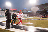 Cason Hohmann (BU - 7) heads off the field after a rain delay was called due to lightning and thunder. - The University of Maine Black Bears defeated the Boston University Terriers 7-3 (2EN) on Saturday, January 11, 2014, at Fenway Park in Boston, Massachusetts.