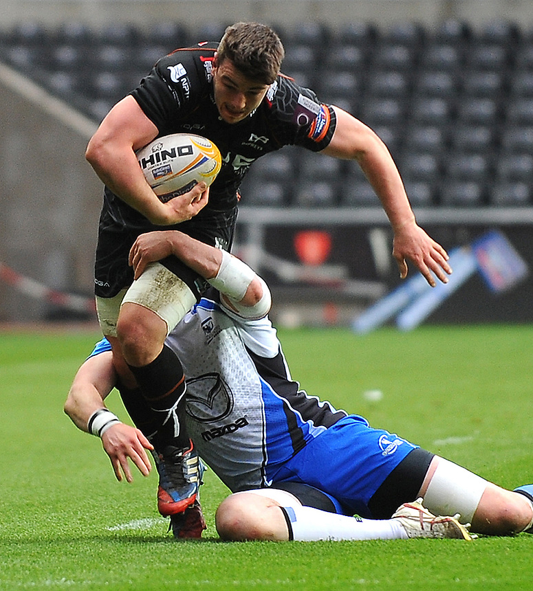 Ospreys' Sam Lewis is tackled by Connacht's Andrew Browne <br /> <br /> Photo by Kevin Barnes/CameraSport<br /> <br /> Rugby Union - RaboDirect PRO12 - Ospreys v Connacht - Saturday 10th May 2014 - Liberty Stadium - Swansea<br /> <br /> &copy; CameraSport - 43 Linden Ave. Countesthorpe. Leicester. England. LE8 5PG - Tel: +44 (0) 116 277 4147 - admin@camerasport.com - www.camerasport.com