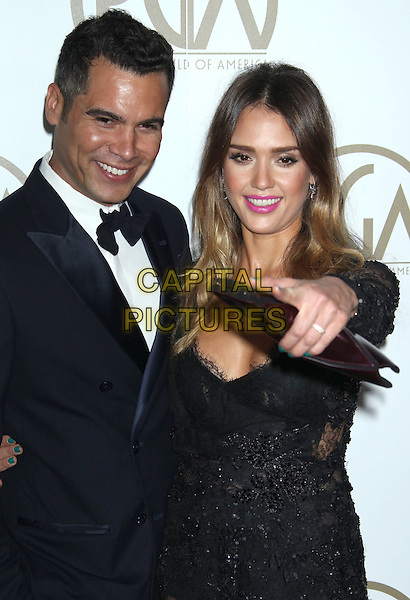Cash Warren, Jessica Alba.At the 24th Annual Producers Guild Awards held at the Beverly Hilton Hotel, Beverly Hills, California, USA,.26th January 2013..PGAs PGA arrivals half length black tuxedo white shirt bow tie lace dress long clutch bag sleeve married husband wife  beaded sheer see thru though hand arm pointing .CAP/ADM/RE.©Russ Elliot/AdMedia/Capital Pictures.