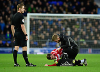 Lincoln City's Michael O'Connor receives treatment for an injury from Lincoln City's head of sports science and medicine Mike Hine<br /> <br /> Photographer Chris Vaughan/CameraSport<br /> <br /> Emirates FA Cup Third Round - Everton v Lincoln City - Saturday 5th January 2019 - Goodison Park - Liverpool<br />  <br /> World Copyright &copy; 2019 CameraSport. All rights reserved. 43 Linden Ave. Countesthorpe. Leicester. England. LE8 5PG - Tel: +44 (0) 116 277 4147 - admin@camerasport.com - www.camerasport.com