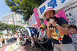 Women Protesters speak at the protest outside METI (Ministry of Economy, Trade and Industry) in Tokyo, Japan. Friday June 29th 2012. About 400 protesters campaigned the restarting of the Oi nuclear power-station and the policy of Prime-Minister Noda to restart Japan's nuclear power generation programme which has been stalled since the earthquake and tsunami of March 11th 2011 caused meltdown and radiation leaks at the Fukushima Daichi Nuclear power-plant.