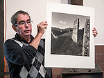 Tony Mornian shows the work of the Great Wall of China photographer Chen Changfen at the 26th Photographers Rendezvous at San Lorenzo Park, King City, Calif.<br /> <br /> A weekend of photographer fellowship, stories, viewing photographs