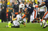 Jan 10, 2011; Glendale, AZ, USA; Auburn Tigers cornerback (22) T'Sharvan Bell tackles Oregon Ducks wide receiver (23) Jeff Maehl during the 2011 BCS National Championship game at University of Phoenix Stadium. The Tigers defeated the Ducks 22-19. Mandatory Credit: Mark J. Rebilas-