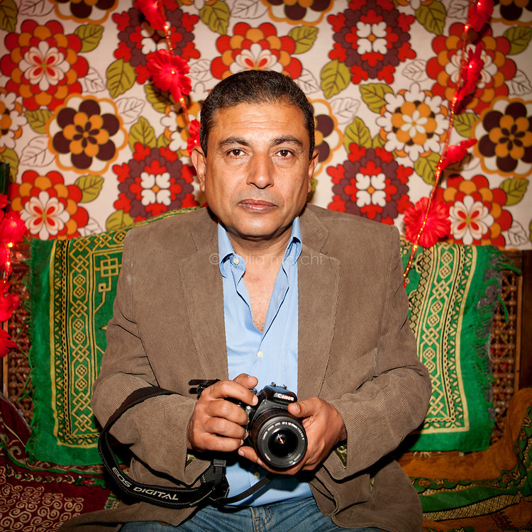 Egypt / Cairo / 4.4.2013 / Adel Wassily, Egyptian photographer, poses with his camera nearby Al Hussein mosque in Cairo. © Giulia Marchi