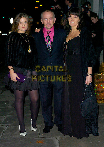 BARRY McGUIGAN & GUESTS.The La Dolce Vita gala, The Old Billingsgate Market, London, UK..December 11th, 2006.full length black suit dress skirt .CAP/CAN.©Can Nguyen/Capital Pictures