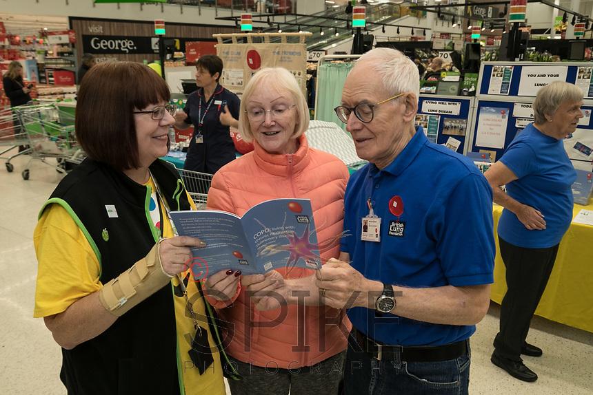 Asda customer Sandra Speyers of Edwalton (centre) meets Asda Community Champion Christine Conway and Malcom Ginever of the Breathe Easy group