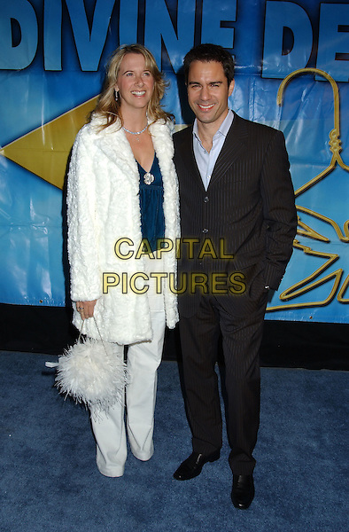 ERIC McCORMACK & WIFE.Design 'Man and Woman of  Style' Awards held at Barker Hanger. .December 2nd, 2004.full length, black pinstripe suit, hand in pocket, married, white fur coat, feather bag, purse.www.capitalpictures.com.sales@capitalpictures.com.© Capital Pictures.