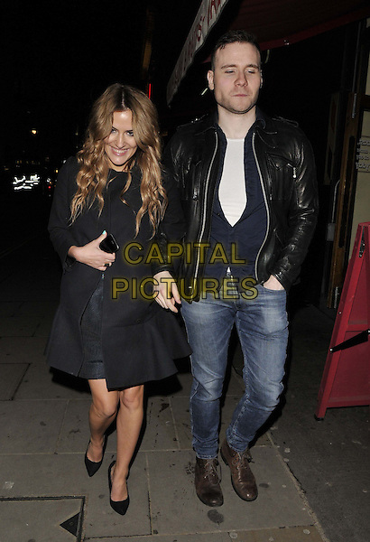 LONDON, ENGLAND - MARCH 26: Caroline Flack &amp; guest depart after the &quot;I Can't Sing!&quot; press night performance, The London Palladium, Argyll St., on Wednesday March 26, 2014 in London, England, UK.<br /> CAP/CAN<br /> &copy;Can Nguyen/Capital Pictures