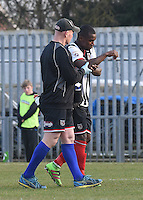 Jon-Paul Pittman of Grimsby Town is helped off after injuring his arm during the FA Trophy Semi Final first leg match between Bognor Regis and Grimsby Town at Nyewood Lane, Bognor Regis, England on 12 March 2016. Photo by Paul Paxford/PRiME Media Images.