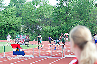 Marquette senior Jared Michel runs to first place finish in the 300 meter hurdles over Mehlville's Patrick Partee and the rest of the field at the Missouri Class 4 Sectional 1 track and field meet at MICDS. Michel finished in 38.88 before tripping up and making a short lived Superman style flying lunge before crashing to the track.