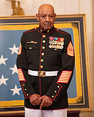 Sergeant Major John L. Canley, United States Marine Corps (Retired) listens as US President Donald J. Trump makes remarks where he will be awarded him the Medal of Honor for conspicuous gallantry during the Vietnam War in a ceremony in the East Room of the the White House in Washington, DC on Wednesday, October 17, 2018.<br /> Credit: Ron Sachs / CNP