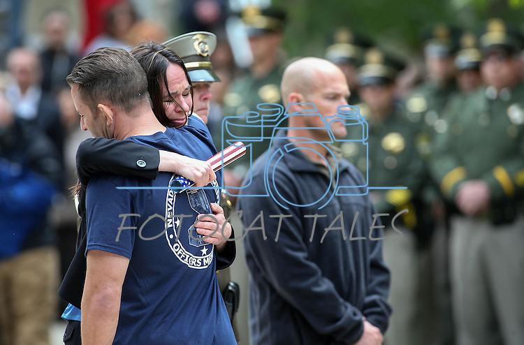 Nicole Beck hugs Las Vegas Metropolitan Police Officer Mike Bland during the annual Nevada Law Enforcement Officers Memorial Ceremony on the Capitol Mall in Carson City, Nev., on Thursday, May 7, 2015. Beck's husband Metro Officer Alyn Beck and his partner Officer Igor Soldo were killed in the line of duty last June. <br /> Photo by Cathleen Allison
