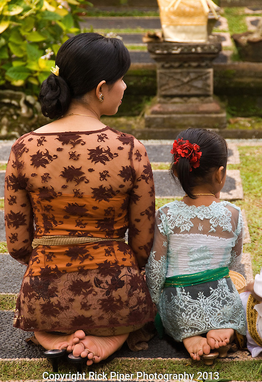 Mother and Daughter - Mother and daughter kneeling at Saraswati Temple, Ubud, Bali, Indonesia