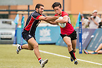 Alessandro Nardoni (l) of Hong Kong battles for the ball with Bronson Ro Kian Cheong of Singapore during the match between Hong Kong and Singapore of the Asia Rugby U20 Sevens Series 2016 on 12 August 2016 at the King's Park, in Hong Kong, China. Photo by Marcio Machado / Power Sport Images