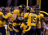 Zach Maynard of California celebrates with teammates after scoring a touchdown during the game against USC at AT&T Park in San Francisco, California on October 13th, 2011.  USC defeated California, 30-9.