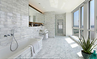 BNPS.co.uk (01202 558833)<br /> Pic:  Johns&Co/BNPS<br /> <br /> Bathroom also has stunning views.<br /> <br /> Fancy joining the Premier league of London property?<br /> <br /> A luxurious London apartment that has been home to a string of Premier League footballers has emerged for sale for close to £2m.<br /> <br /> The lavish home is on the 25th and 26th floors of the stylish Ontario Tower in Ballymore, close to Canary Wharf.<br /> <br /> It's prime location and stylish facilities have made it a favourite of West Ham United players with three internationals having lived there.