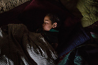Sajab, 7 years old, is sleeping in the room of his father, Yekalong, Afghanistan, 9th November 2017. <br /> <br /> Sajab, 7 ans, dort dans la chambre de son père, Yekalong, Afghanistan, 9 Novembre 2017.
