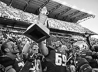 Cory Fuavai hoists the Apple Cup trophy.