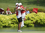SINGAPORE - MARCH 08:  Jiyai Shin of South Korea celebrates with her caddie during the final round of HSBC Women's Champions at the Tanah Merah Country Club on March 8, 2009 in Singapore.  Photo by Victor Fraile / The Power of Sport Images