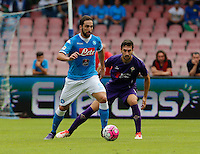 Napoli's Gonzalo Higuain     in action  past Fiorentina's Davide Astori  during the Italian Serie A soccer match between SSC Napoli and AC Fiorentina  at San Paolo stadium in Naples,October 18, 2015