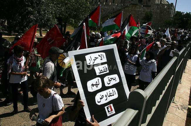 Israeli, Palestinian and foreign activists march calling for an independent Palestinian state on July 15, 2011. Some 1,000 Israelis and Palestinians gathered in east Jerusalem for a protest march to support the Palestinian bid for United Nations recognition of their state. Photo by Mahfouz Abu Turk