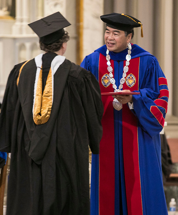 DePaul University President A. Gabriel Esteban, Ph.D., hands out awards to faculty members during his first Academic Convocation at the St. Vincent de Paul Parish Church Thursday, Aug. 31, 2017, on the Lincoln Park campus. (DePaul University/Jamie Moncrief)
