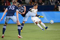 CARSON, CA - MARCH 07: Rolf Feltscher #25 of the Los Angeles Galaxy sends a cross ball during a game between Vancouver Whitecaps and Los Angeles Galaxy at Dignity Health Sports Park on March 07, 2020 in Carson, California.