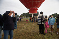 Balloon pilots prepare hot air balloons for take-off at the Great Prosser Balloon Rally in Prosser, Washington, USA.