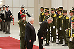 Palestinian President Mahmoud Abbas and his Austrian counterpart Alexander Van der Bellen inspect honor guard during a welcoming ceremony in the West Bank city of Ramallah on February 5, 2019. Photo by Ahmad Arouri