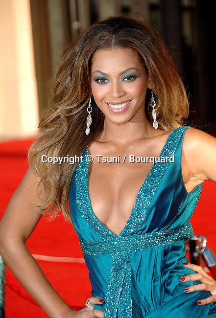 Beyonce Knowles arriving at American Music Awards ( AMA ) at the Shrine Auditorium in Los Angeles.<br /> <br /> headshot<br /> smile<br /> eye contact