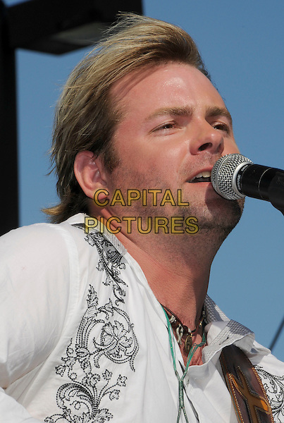 ANDY GRIGGS.2008 CMA Music Festival Greased Lightning Riverfront Daytime Stage, Nashville, Tennessee, USA, .05 June 2008..country music microphone concert gig on stage portrait headshot .CAP/ADM/LF.©Laura Farr/Admedia/Capital PIctures