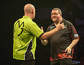 09.04.2015. Sheffield, England. Betway Premier League Darts. Matchday 10.  Stephen Bunting [ENG] congratulates Michael van Gerwen [NED] after the winning double in their match.