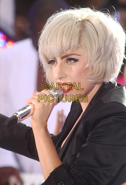 "LADY GAGA (Stefani Joanne Angelina Germanotta) .performs live on NBC's ""TODAY"" Show at Rockefeller Center, New York, NY, USA, 9th July 2010..on stage music concert gig portrait headshot black jacket blazer microphone singing  make-up red lipstick .CAP/ADM/AC.©Alex Cole/AdMedia/Capital Pictures."
